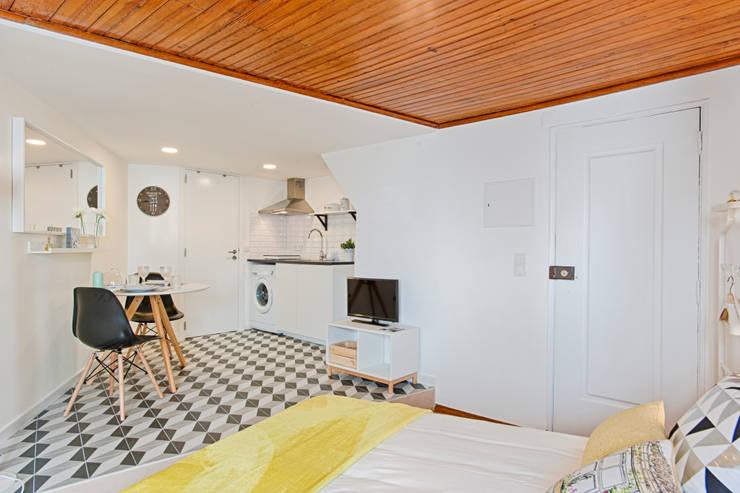 Sala de Estar : Salas de estar  por menta, creative architecture