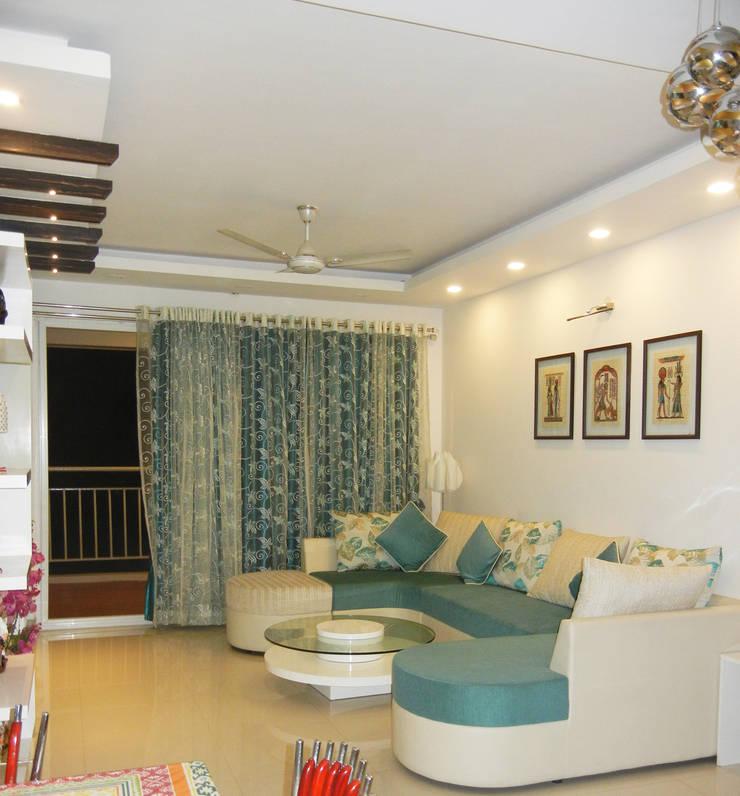 Living room : modern  by Interiors By Suniti,Modern