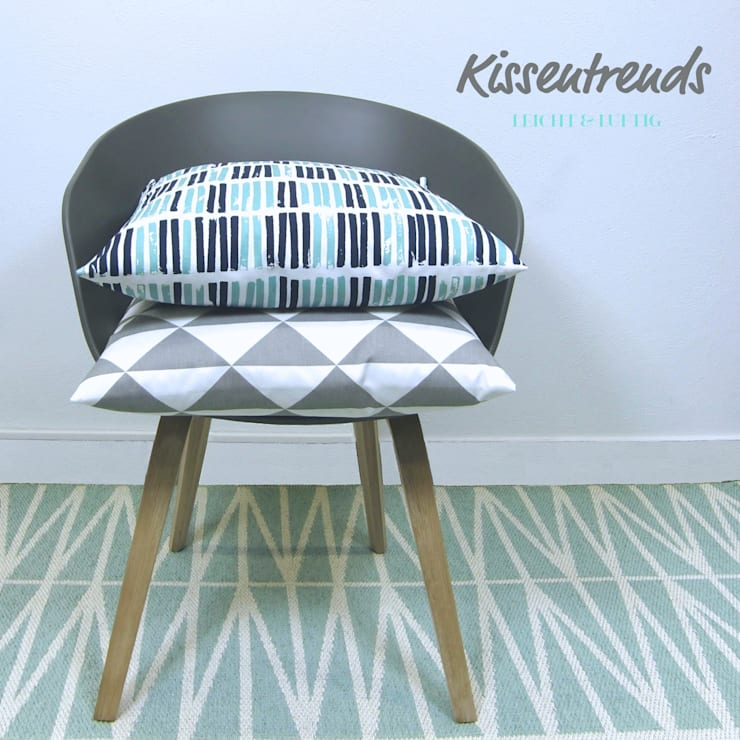 Living room by SCHÖNE KISSEN