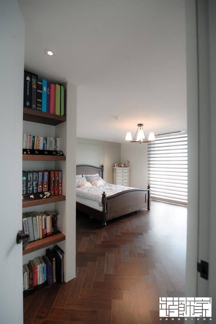 시공부터 전체 홈스타일링까지, 모던하게 꾸민 아파트 인테리어: ㈜장식가의  침실