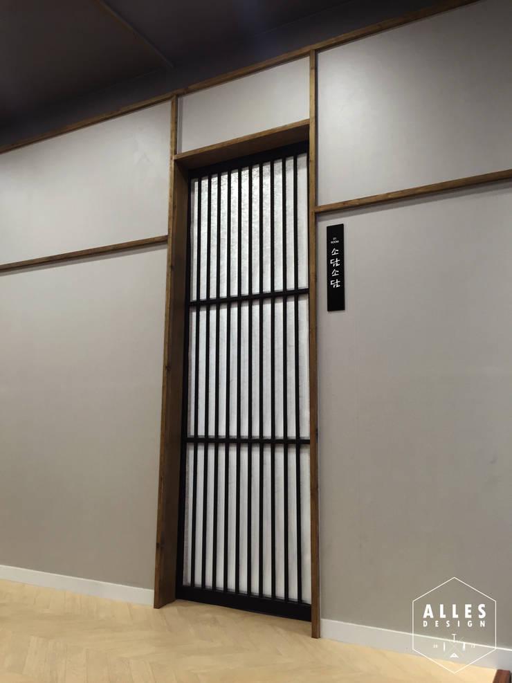 회롱회롱 _ Sliding door: 디자인알레스의  상업 공간,