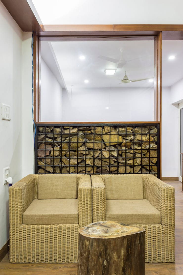 The gabion wall and the sitting space:  Offices & stores by Manuj Agarwal Architects,Modern