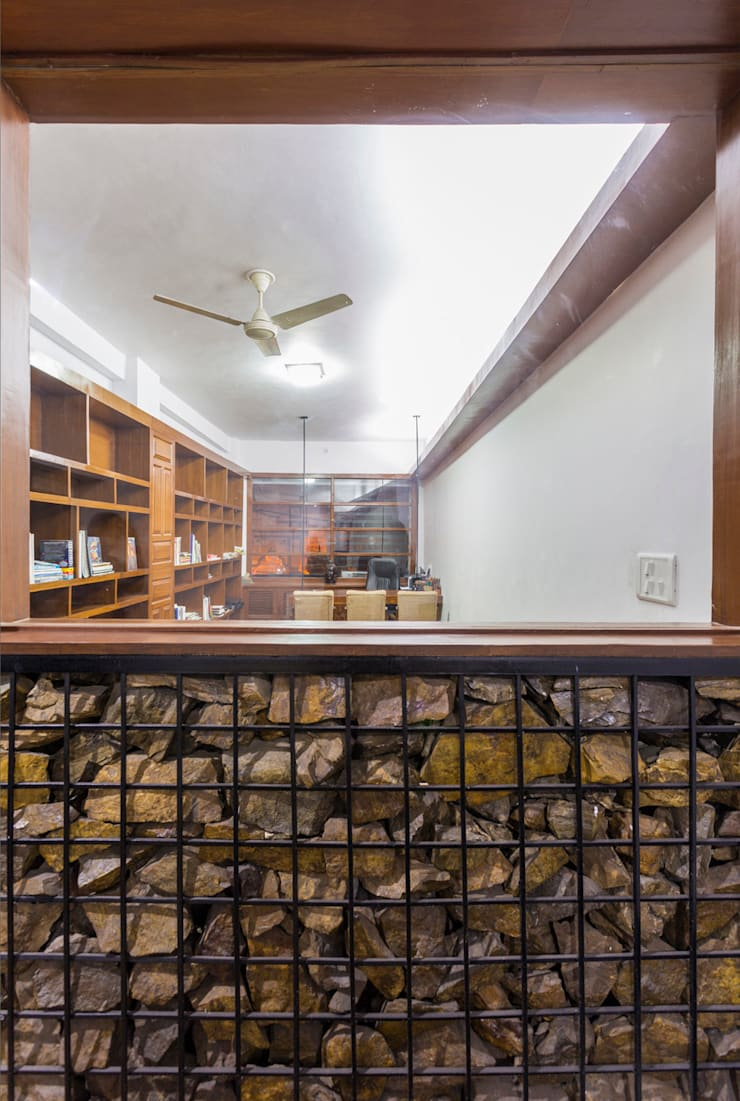 The Gabion wall:  Offices & stores by Manuj Agarwal Architects,Modern