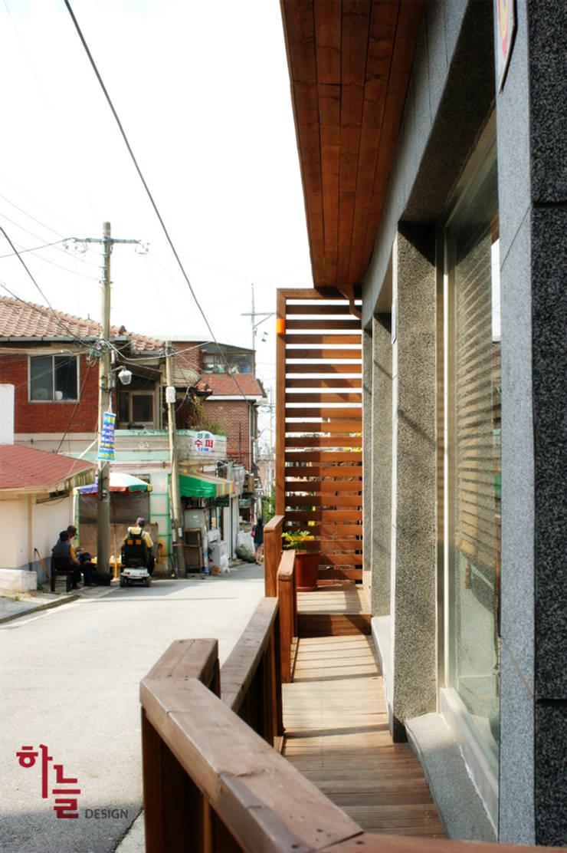 시흥동-옥탑방상가: 하늘디자인의  상업 공간,
