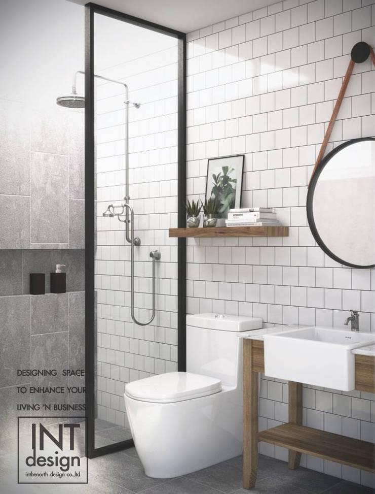 ห้องน้ำแสนสุข:  ตกแต่งภายใน by Inthenorth Design Co.,Ltd