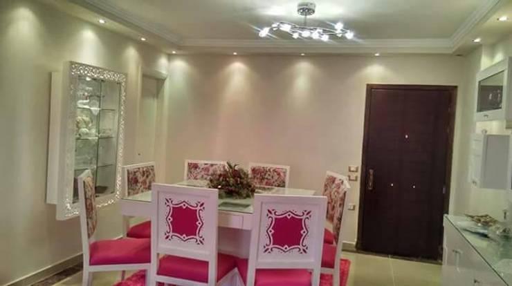 غرفه السفرة بلمسات مودرن مع شركة كاسل:   تنفيذ كاسل للإستشارات الهندسية وأعمال الديكور في القاهرة,