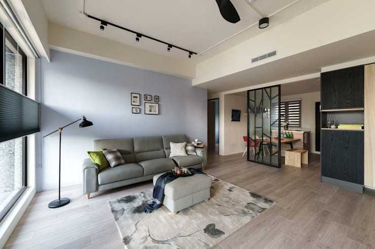 Living room by 羽筑空間設計
