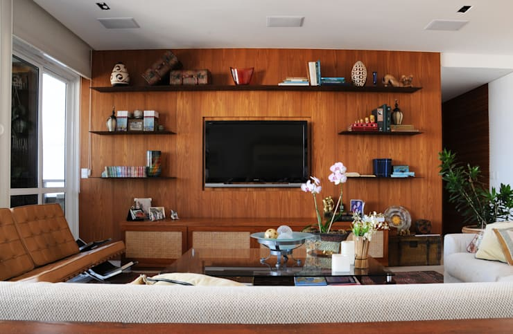 Marcenaria leve e elegante: Salas de estar  por daniela kuhn arquitetura