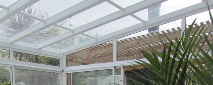 REMODELACION Y AMPLIACION DEPARTAMENTO EN VILLA LURO – CABA: Jardines de invierno de estilo  por Arquitecta MORIELLO