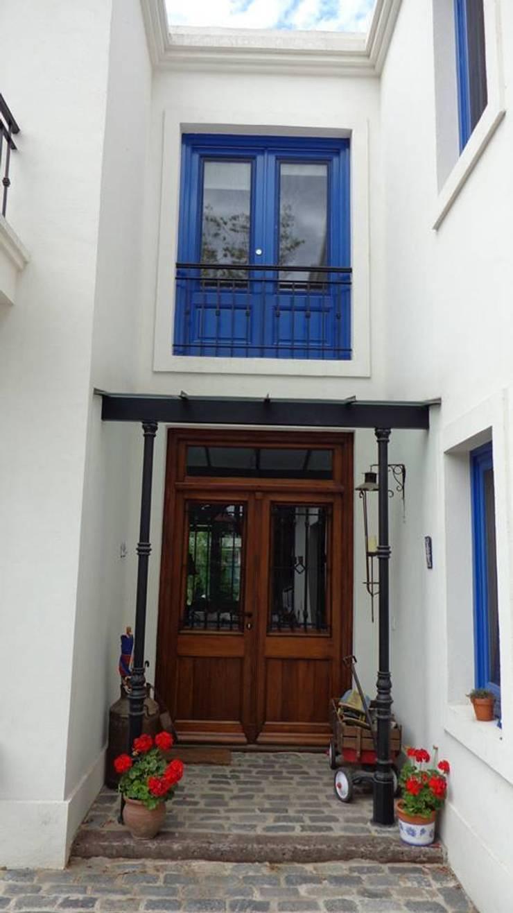Casa en San Isidro: Casas de estilo  por Rocha & Figueroa Bunge arquitectos,