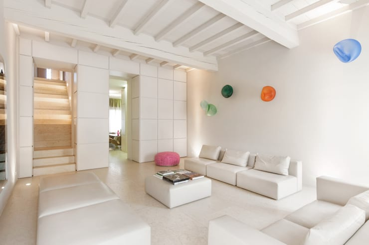 Livings de estilo  por studio di architettura DISEGNO