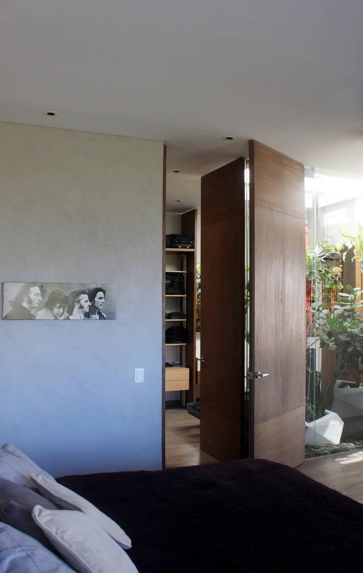 Remodelación Apartamento Echeverry: Habitaciones de estilo  por Contrafuerte Arquitectura