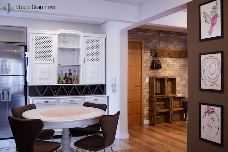 Sala de Jantar: Salas de jantar  por Studio Grammés • Arquitetura,Moderno