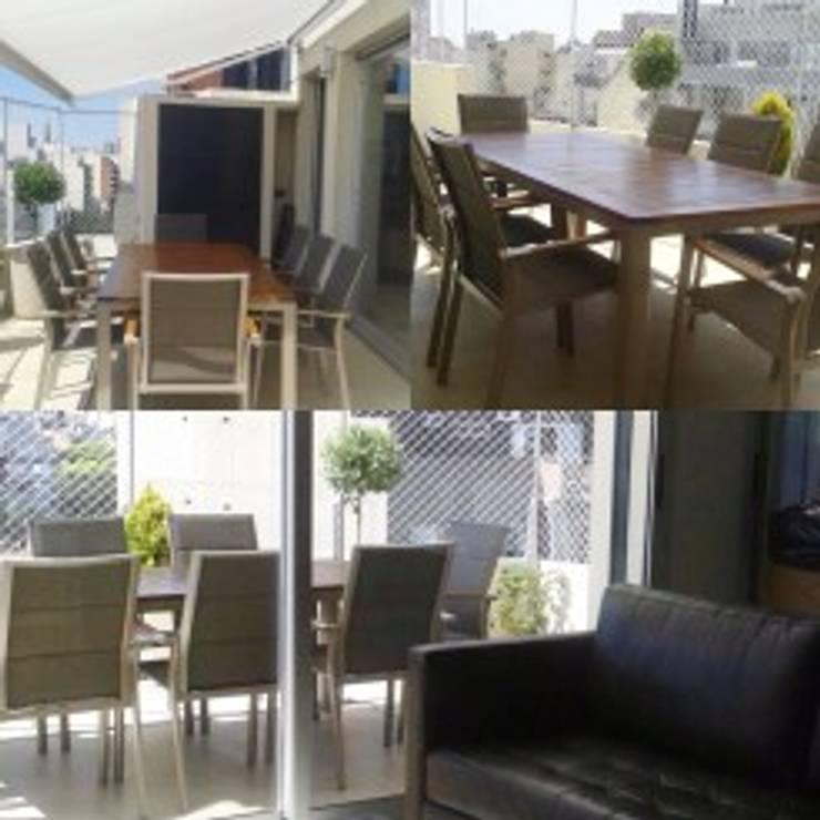 DISEÑO INTERIOR Y DE MOBILIARIO DE UN DEPARTAMENTO EN CABALLITO: Balcones y terrazas de estilo  por Arquitecta MORIELLO,