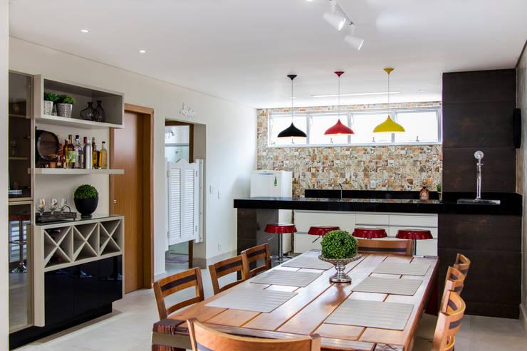 Área gourmet: Cozinhas  por Novità - Reformas e Soluções em Ambientes