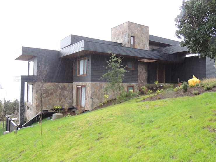 casa Bambach – Vial: Casas de estilo  por David y Letelier Estudio de Arquitectura Ltda.