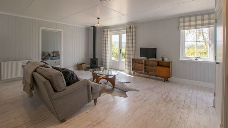 Salas de estilo  por The Wee House Company,