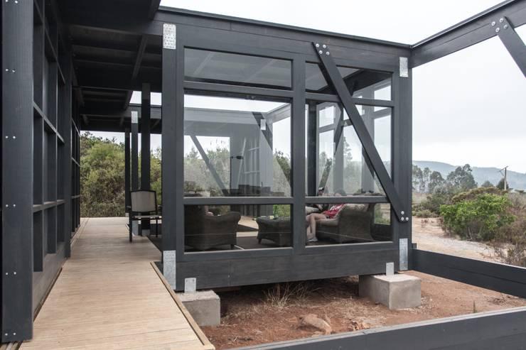 Deck Tunquen: Casas de estilo  por MACIZO Arquitectura y Construcción Limitada