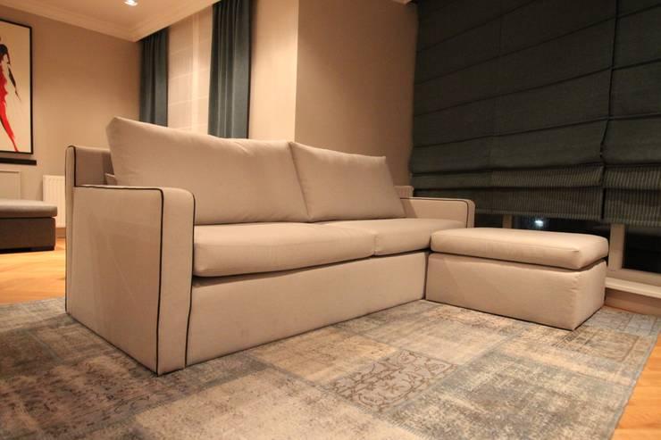 غرفة المعيشة تنفيذ Comfort & Style Interiors