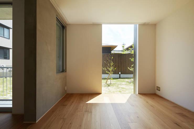 カントK: 一級建築士事務所 こよりが手掛けたリビングです。