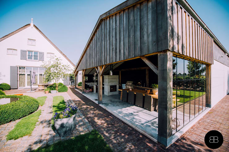 Country style garden by Buro Buitenom exterieurontwerpers Country