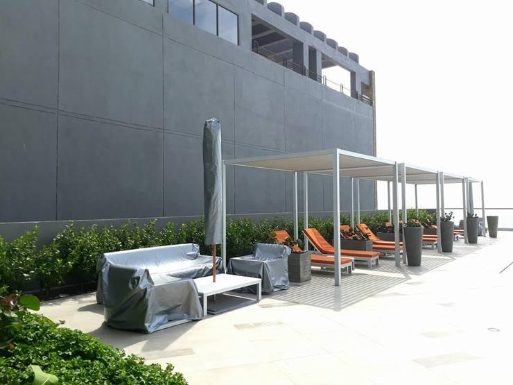 Jardines Edificio Morros City / Cartagena: Jardines de estilo tropical por ecoexteriores