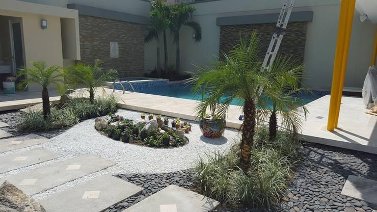 Casa residencial jardines / Barranquilla - ATL: Jardines de estilo  por ecoexteriores