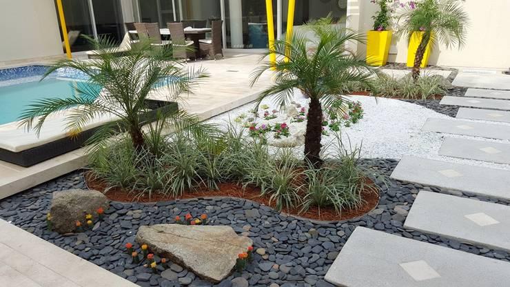 Casa residencial jardines / Barranquilla – ATL: Jardines de estilo  por ecoexteriores
