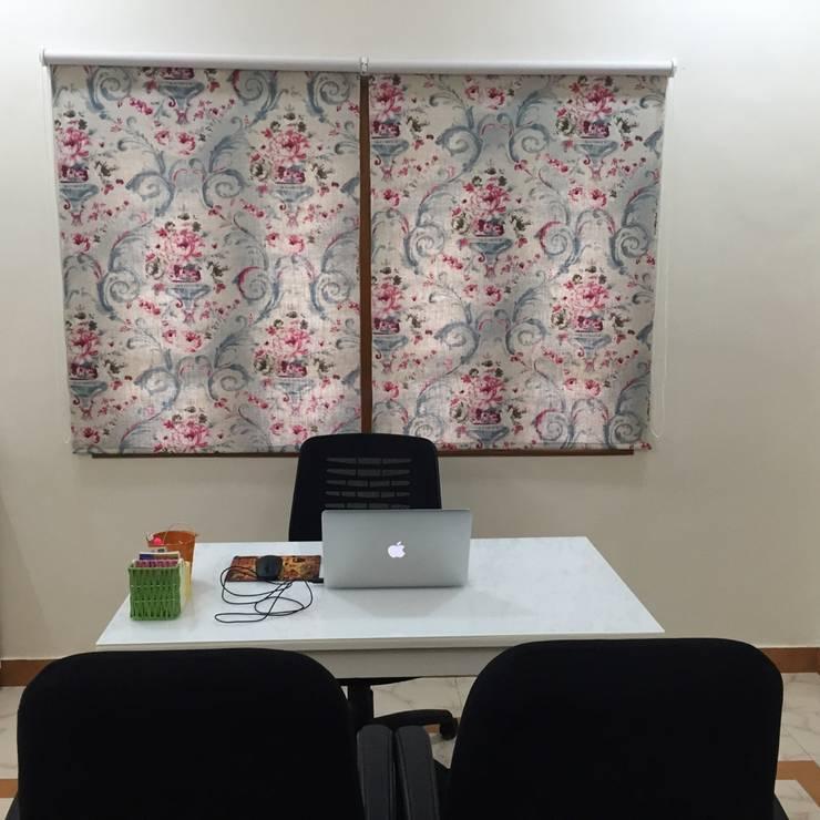 Design studio for a client:  Office spaces & stores  by Sanchi Shah