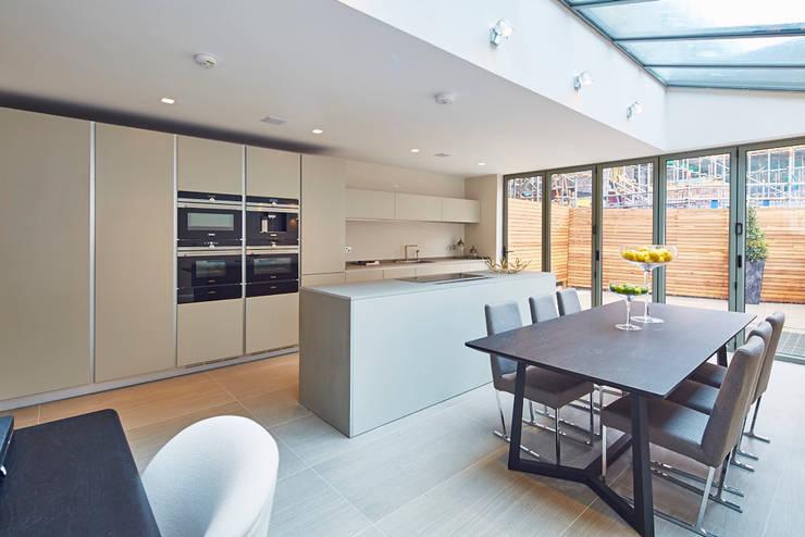 Wolverton Gardens, W6:  Dining room by APT Renovation Ltd
