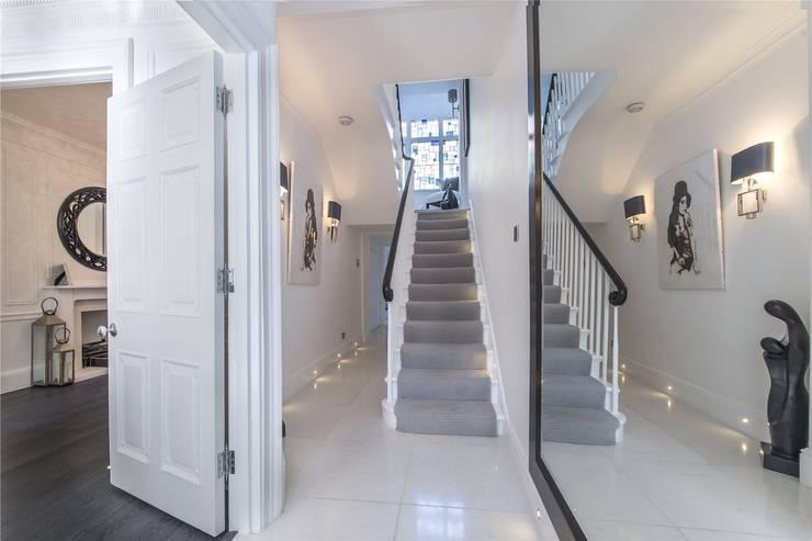 Victoria Square, London SW1W:  Corridor & hallway by APT Renovation Ltd