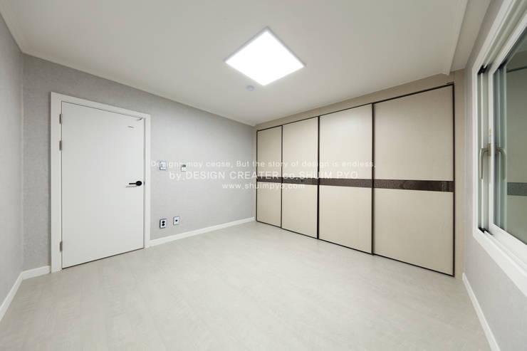 안방: 쉼표디자인SHUIMPYO DESIGN의  방