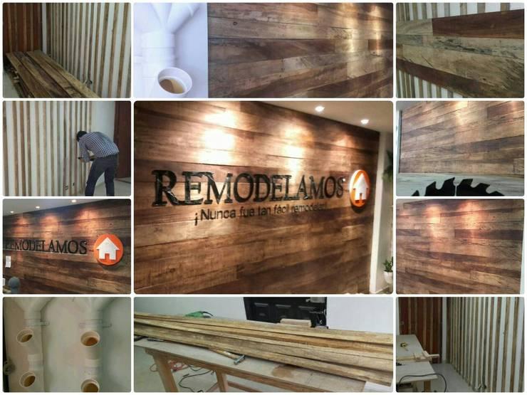 Proceso de corte e instalacion de mural. : Edificios de oficinas de estilo  por Remodelamos.casa