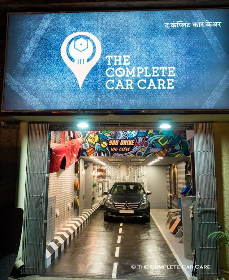The Complete Car Care (car garage studio): industrial Garage/shed by Sollace Designz