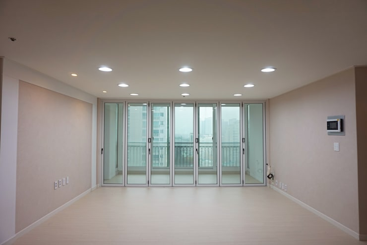 센텀비치푸르지오 35평형 인테리어: 빅터인디자인그룹의  거실,모던