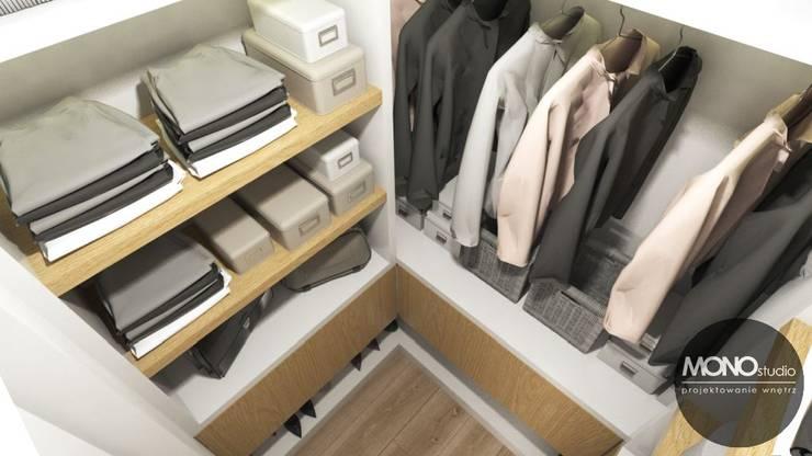 Vestidores y closets de estilo moderno por MONOstudio