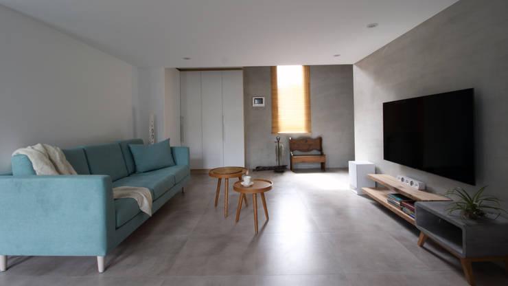 Living room by 樂沐室內設計有限公司,