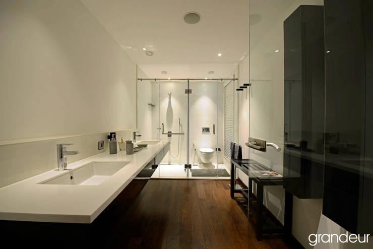 Villas: modern Bathroom by Grandeur Interiors
