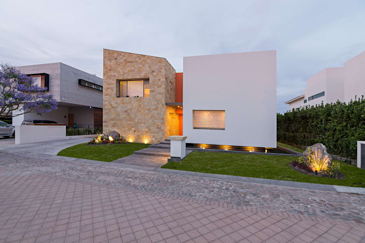 Casas de estilo  por espacio   NUEVE CERO UNO