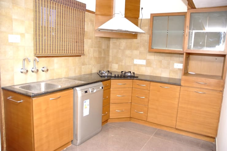 Contemporary L Shaped Kitchen Designs:  Kitchen by Scale Inch Pvt. Ltd.