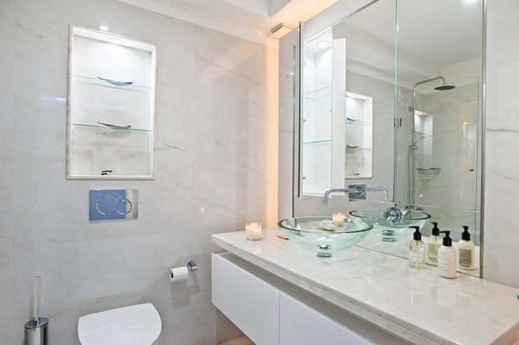Instalação Sanitária Comum: Casas de banho  por menta, creative architecture