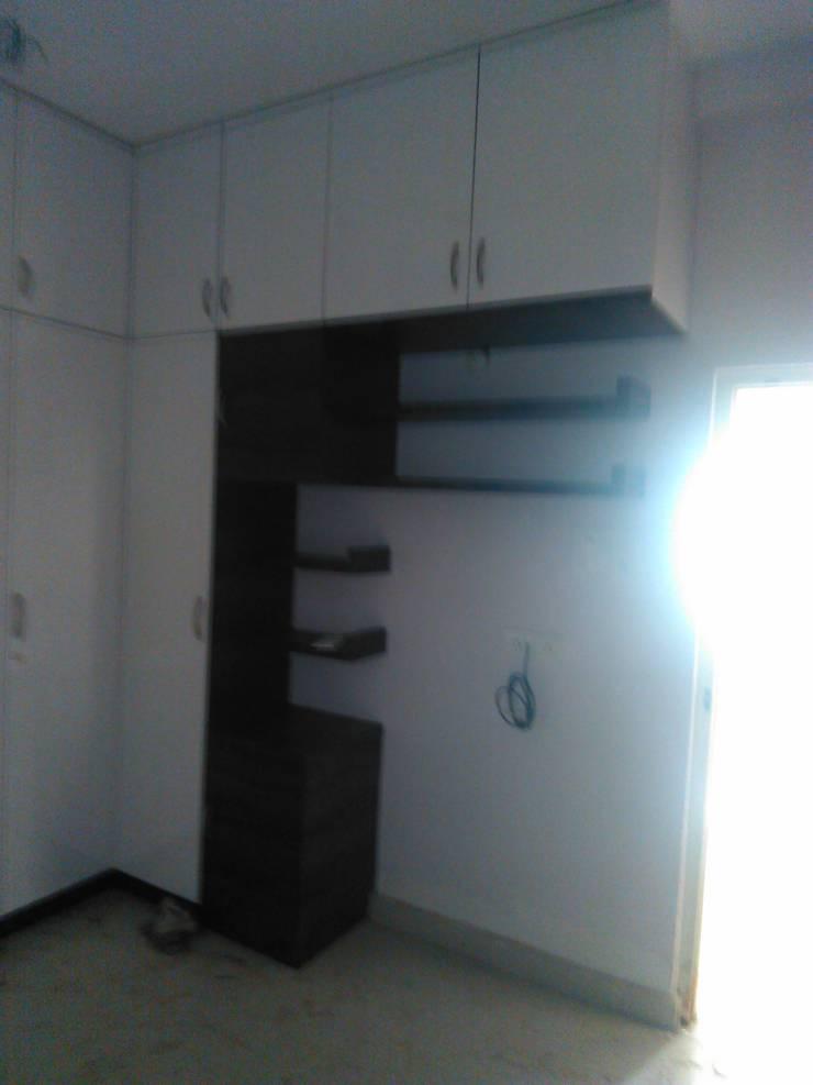 book shelf and wardrobe: minimalistic Bedroom by BYOD Dezigns