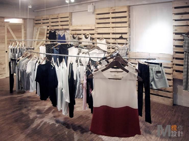 再生/概念服飾店面:  商業空間 by 橙作設計/M.D.S