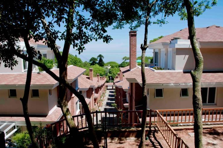 Casas de estilo  por CABRAL Arquitetos, Rústico Ladrillos