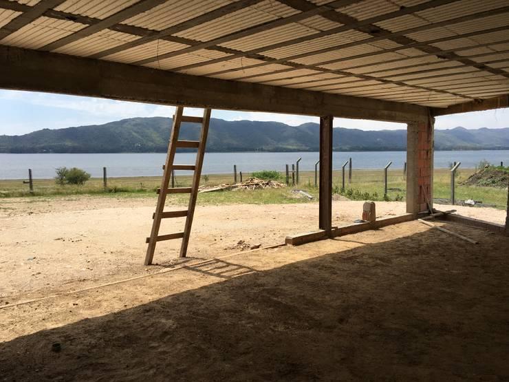 Casa NC: Livings de estilo minimalista por Development Architectural group