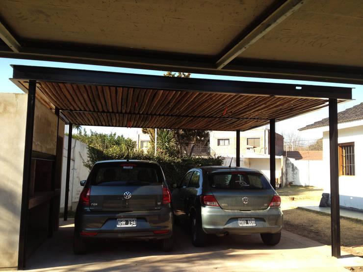 QUINCHO/GARAGE MPG: Casas de estilo  por Development Architectural group