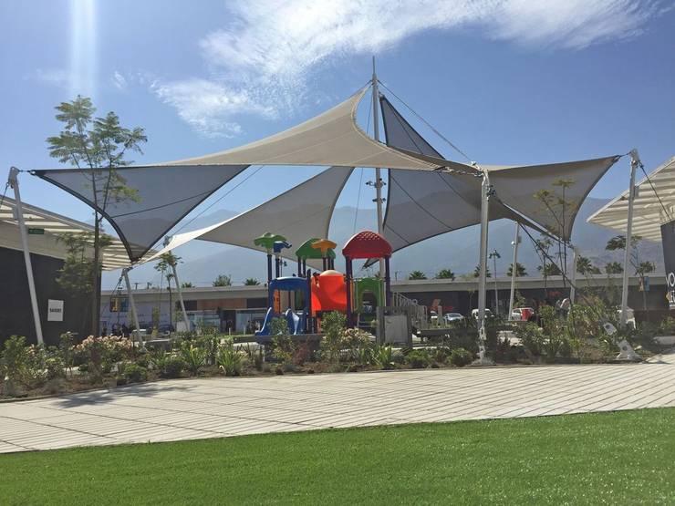 Vivo Outlet La Florida: Centros Comerciales de estilo  por Espacio Cubierto