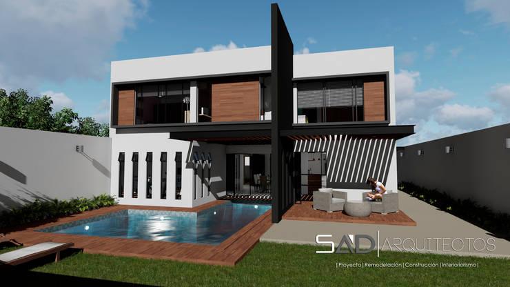 Fachada Posterior: Casas de estilo  por Studio Arch'D Arquitectos