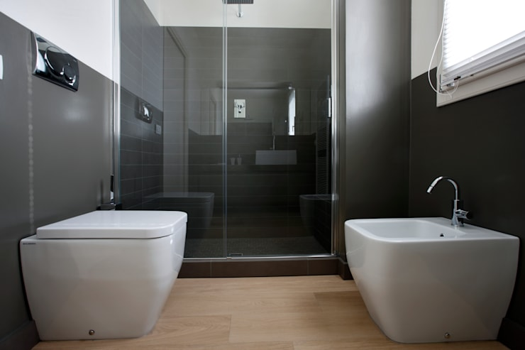 Baños de estilo moderno por Daniela Nori