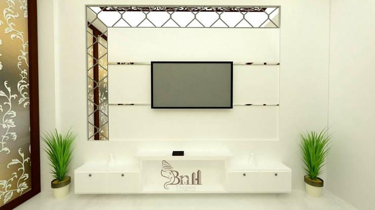 Residential Duplex Villa:  Living room by BNH DESIGNERS